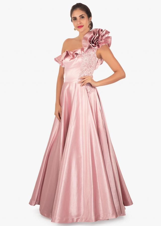 Rose gold heavy satin gown with 3D flower and one sided neckline only on Kalki