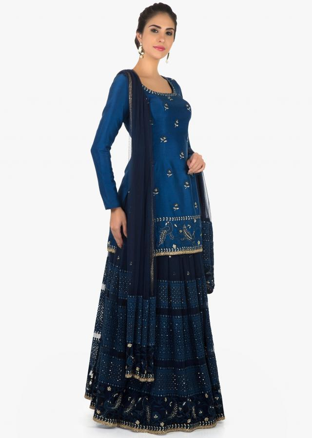Royal blue and navy blue lehenga with long top in silk with bird motif embroidery only on Kalki