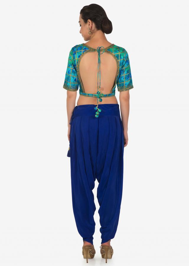 Royal blue dhoti pants matched with shaded crop top blouse in kundan embroidery only on Kalki