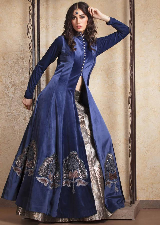 Royal blue long velvet jacket in french knot work matched with silver lehenga