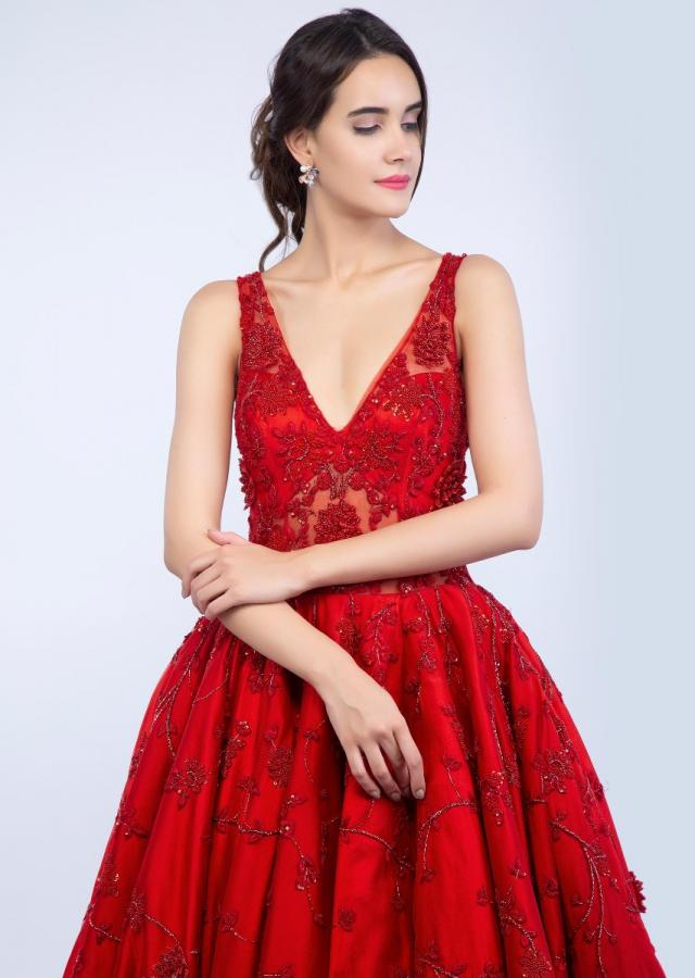 Ruby red deep V neck embroidered net gown with feather hem only on Kalki