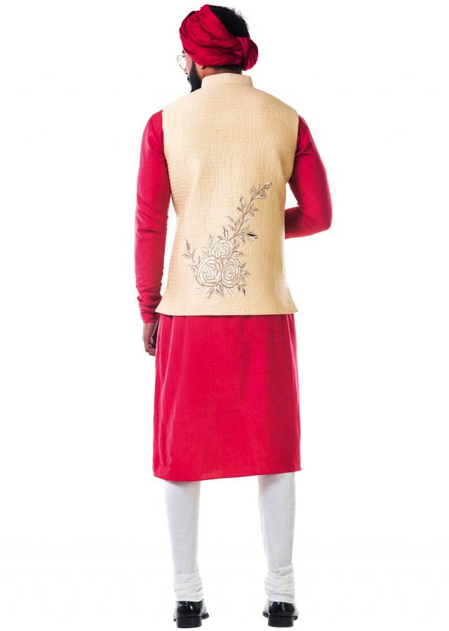 Rust side buttoned cowl kurta set with an off-white quilted jacket with thread work embroidery only on Kalki