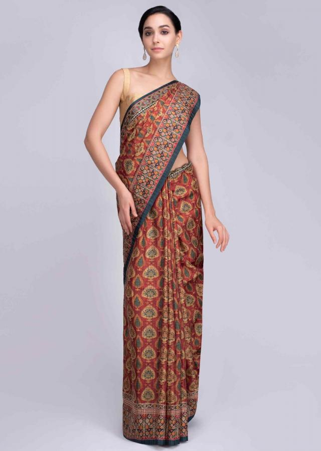 Rustic red patola printed saree in abstract motif only on Kalki
