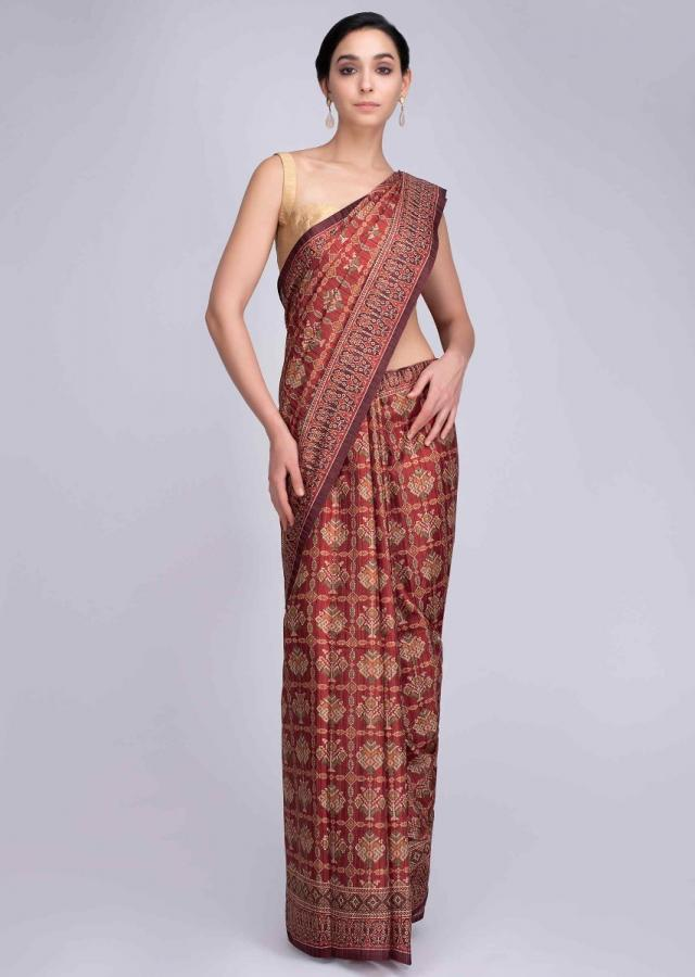 Rustic red patola printed saree with tassels on the pallo only on Kalki