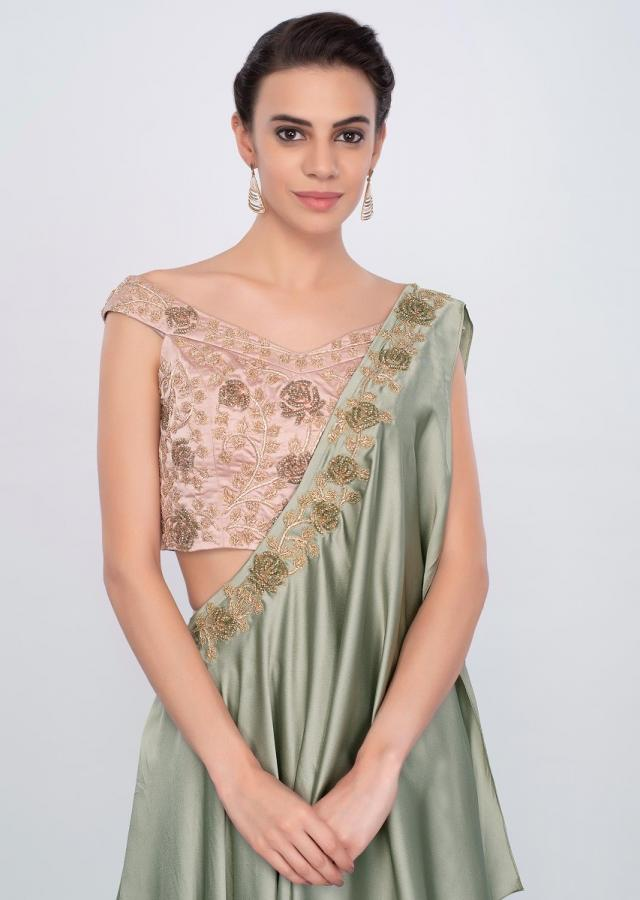Sage green skirt with off shoulder blouse and fancy wrap around dupatta only on Kalki