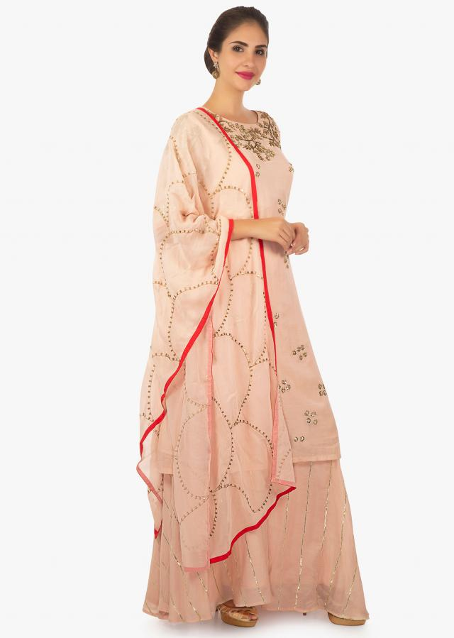 Salmon peach cotton palazzo set matched with a chiffon dupatta only on Kalki