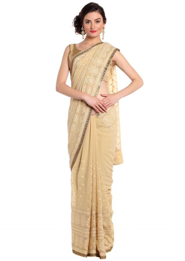 Sand beige saree adorn in thread and kundan embroidery only on Kalki