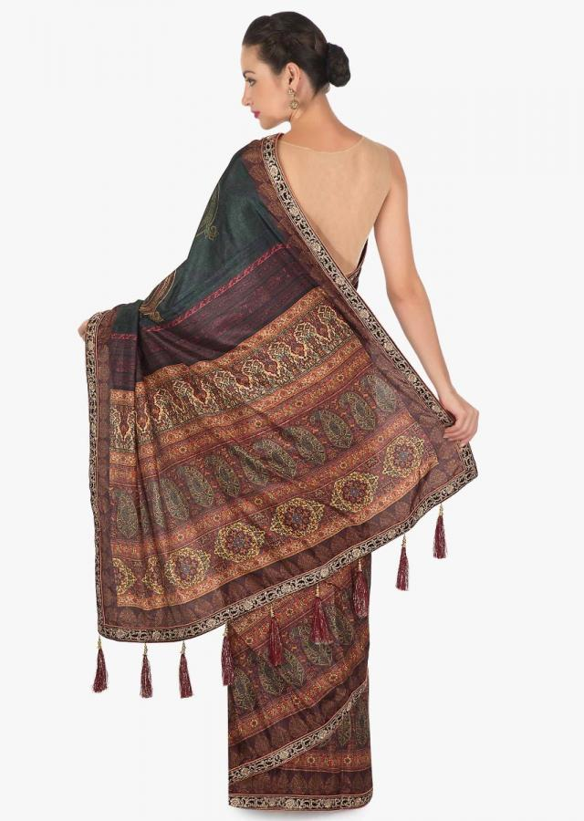 Saree in rust and brown shade with flroal print with fancy tassel only on Kalki