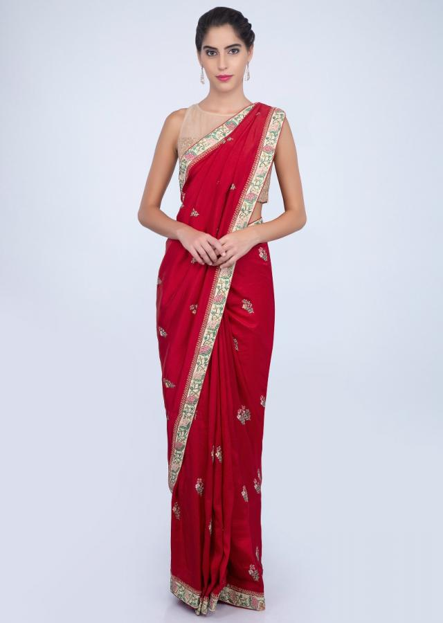 Scarlett red dupion silk saree with floral embroidered butti and border only on kalki