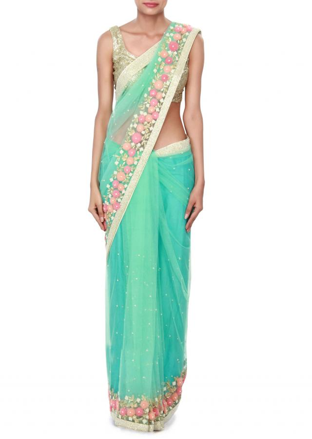Sea blue saree enhanced in 3D flower only on Kalki