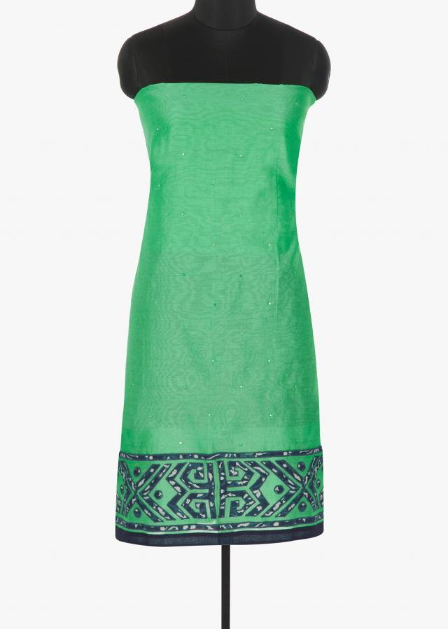 Sea  green cotton silk unstitched suit enhanced with applique work at the hemline only on Kalki