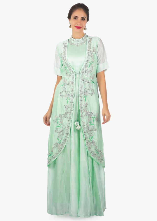 Sea green long dress in high neck matched with a long jacket only on Kalki