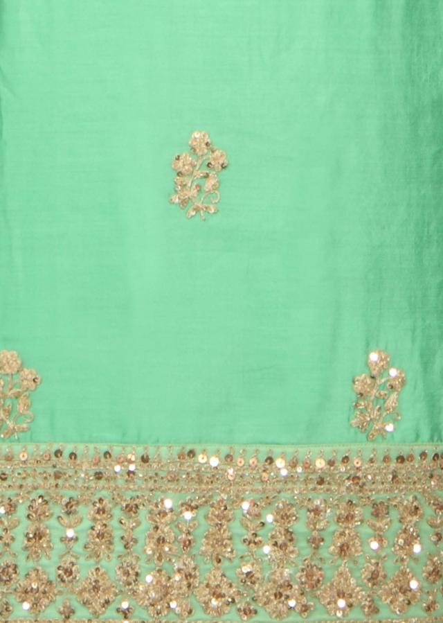 Green unstitched suit in kundan embroidered border only on Kalki