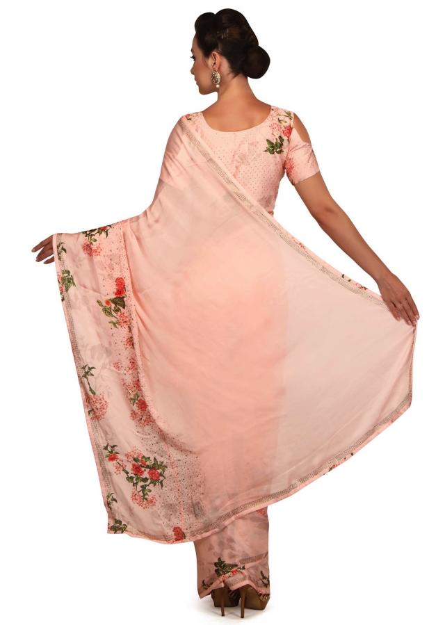 Seashell pink saree with floral printed border and kundan only on Kalki