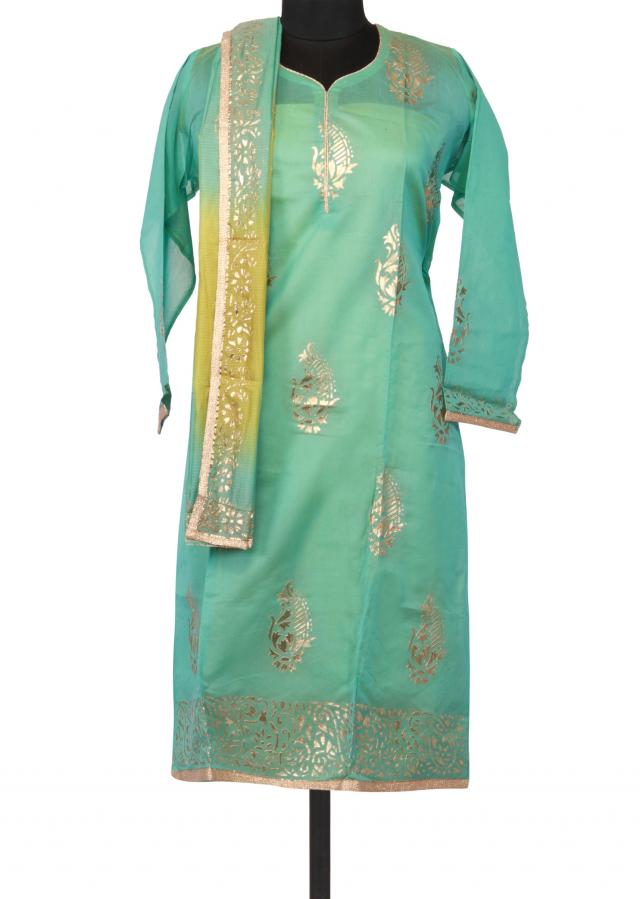 Semi stitched suit in pool blue with embossed foil printed butti