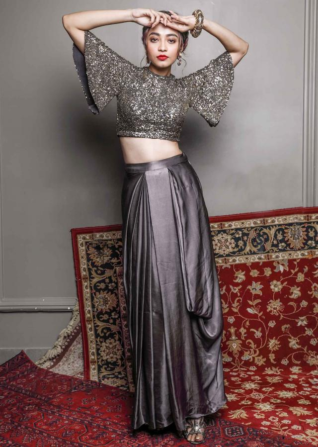 Sequins encrusted blouse paired with a satin silk charcoal grey skirt only on kalki