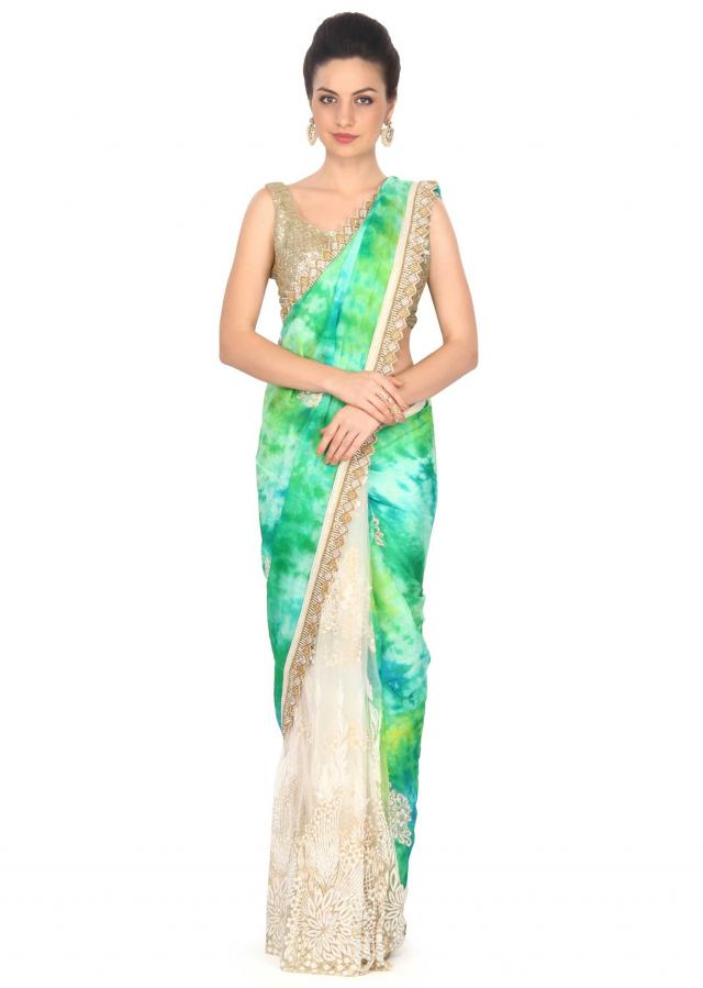 Shaded saree in green with embellished butti and border only on Kalki