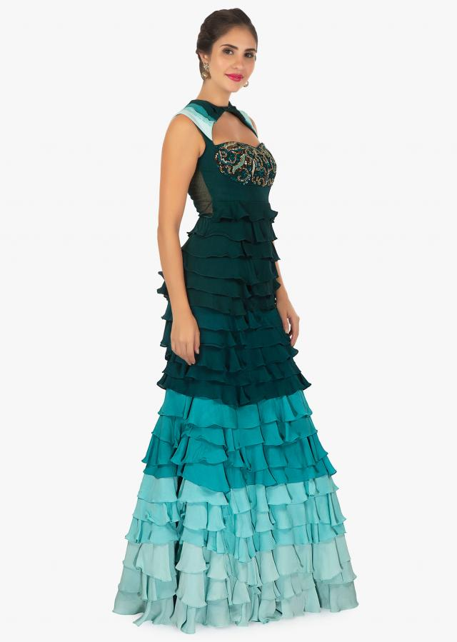 Shaded teal multiple layer gown intricated with sequins and cut dana  only on Kalki
