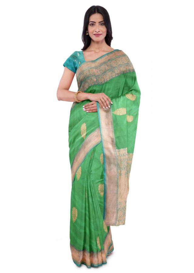Shamrock green banarasi saree with turq blouse piece only on Kalki