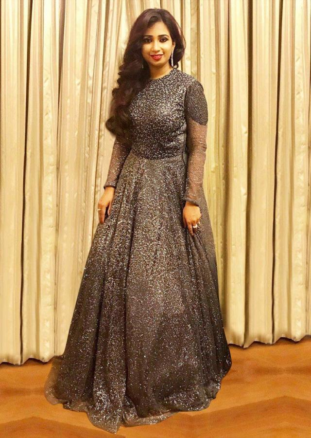 Shreya Goshal in Kalki graphite grey flared ballroom gown adorn with self shimmer beads