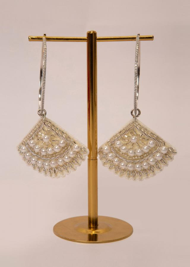 Silver hoop earring with a fabric based drops