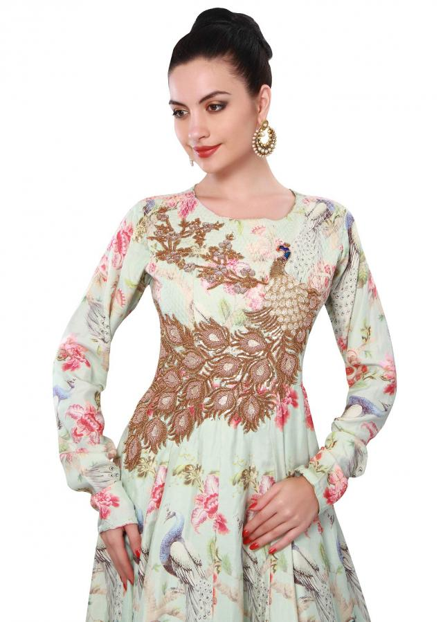 Sky blue anarkali suit adorn in peacock motif embroidery only on Kalki