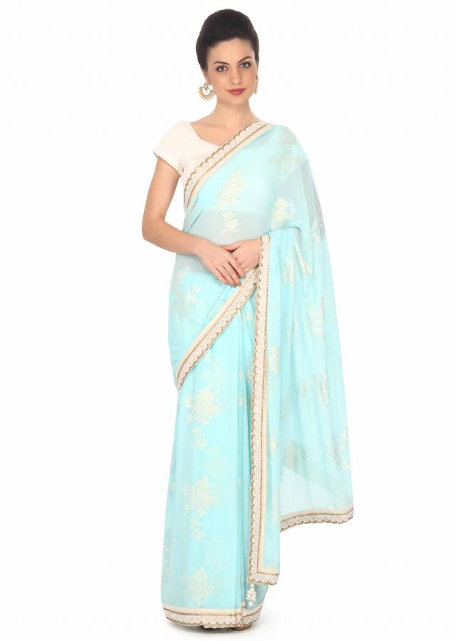 Glowing blue chiffon saree with embellished border only on Kalki