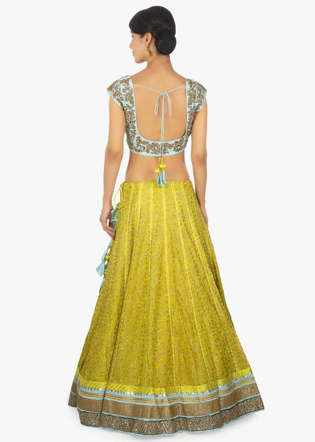 Sky Blue Blouse In Embellished Raw Silk Paired With A Canary Yellow Georgette Lehenga And Net Dupatta Online - Kalki Fashion