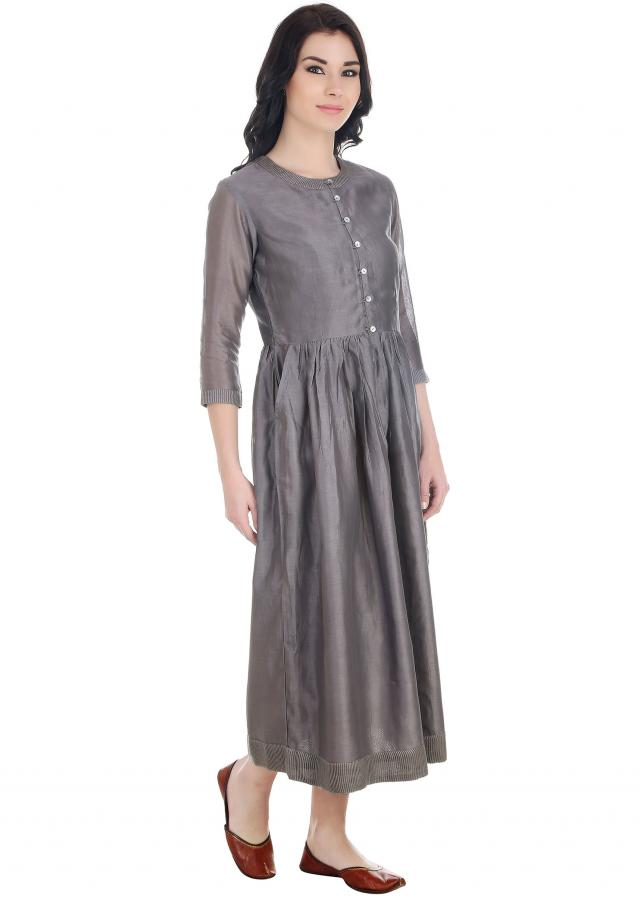Step out in this button down chanderi silk dress