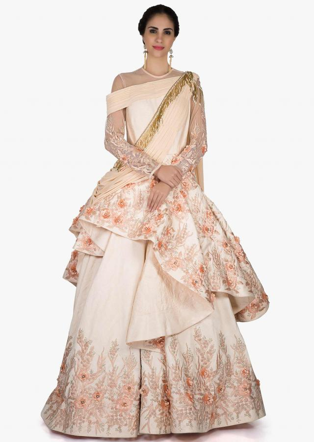 Stunning gown in cream pink with stunning embroidery in pearls and beautiful drape only on Kalki