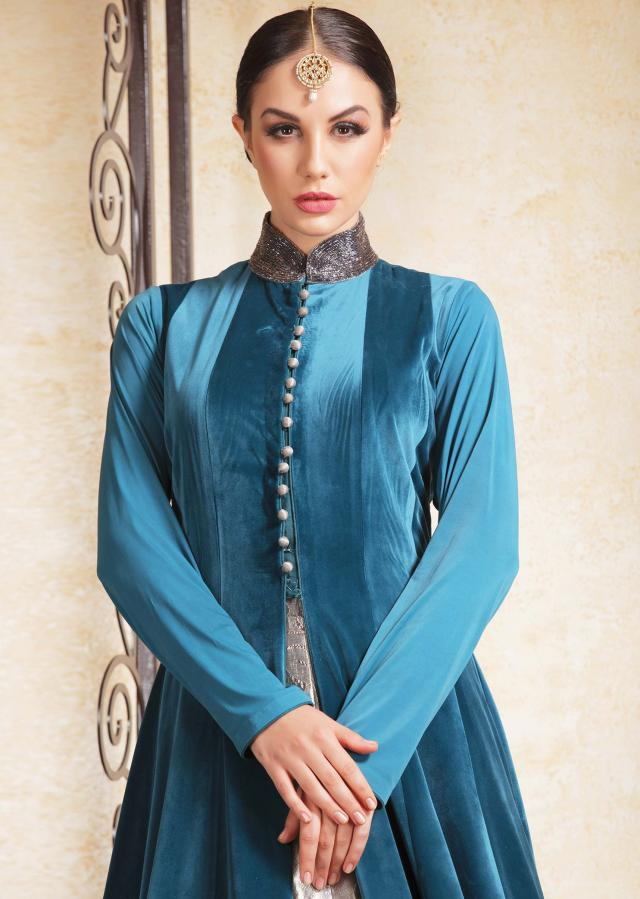 Teal blue long velvet jacket in french knot work matched with silver lehenga