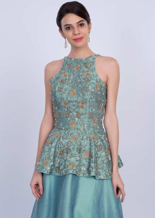 Turq blue halter neck peplum top with matching organza skirt only on Kalki