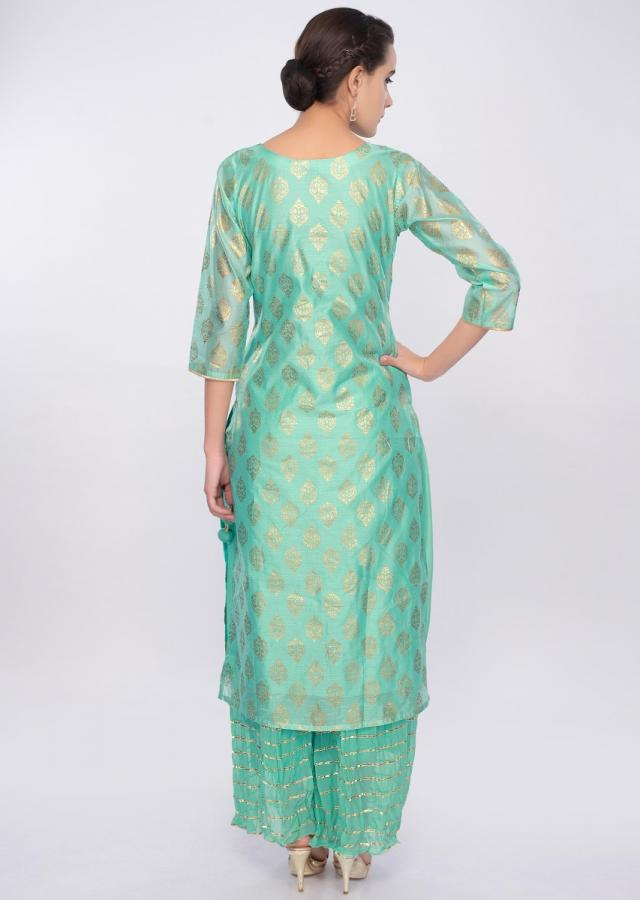 Turq green foil printed suit with crushed georgette palazzo only on Kalki