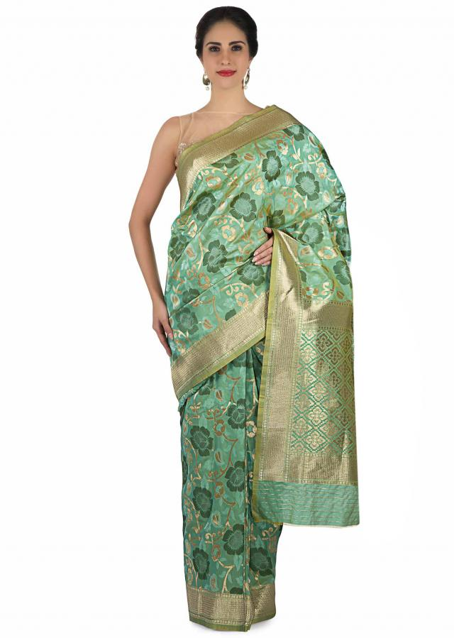 Turq green saree in brocade silk in floral motif with gold pallav and border only on Kalki