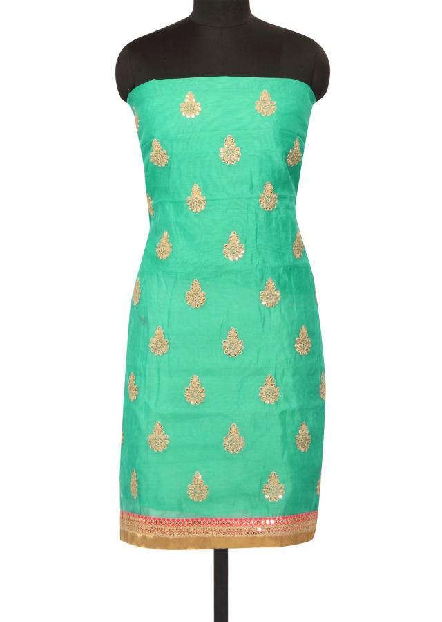 Turq green unstitched suit in sequin nad zari butti only on Kalki