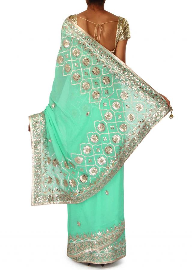 Turq saree with gotta patch embroidered pallav only on Kalki
