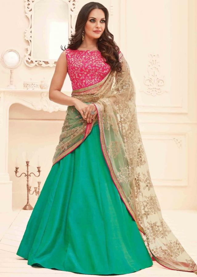 turq green lehenga in raw silk with pink blouse and beige dupatta in sequin work