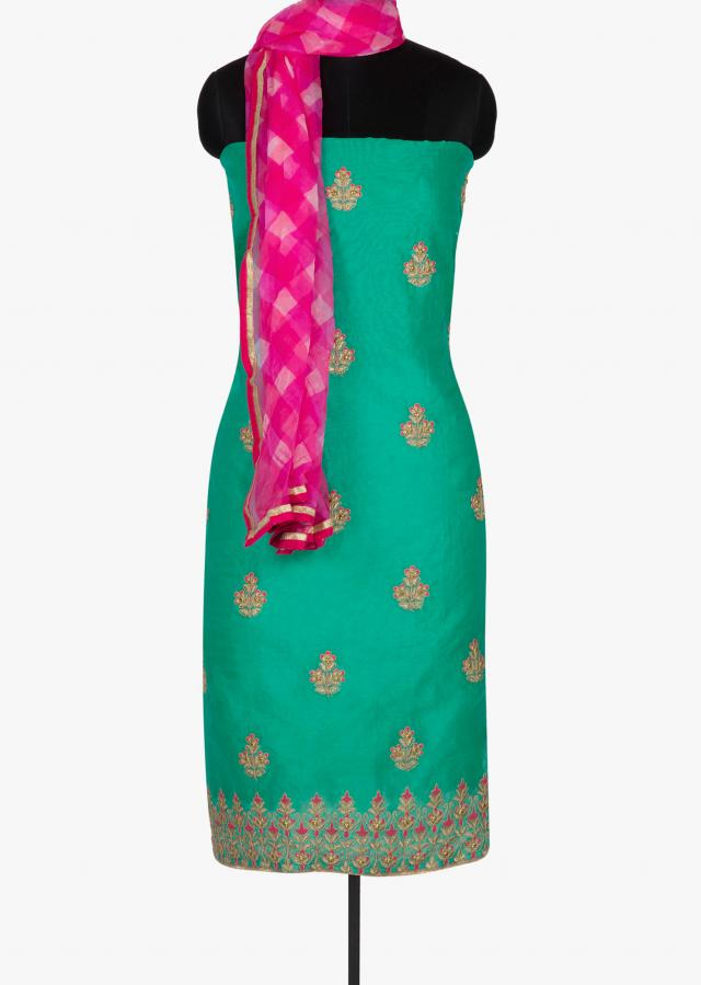 Turq green unstitched suit in zari butti and leheriya dupatta only on Kalki