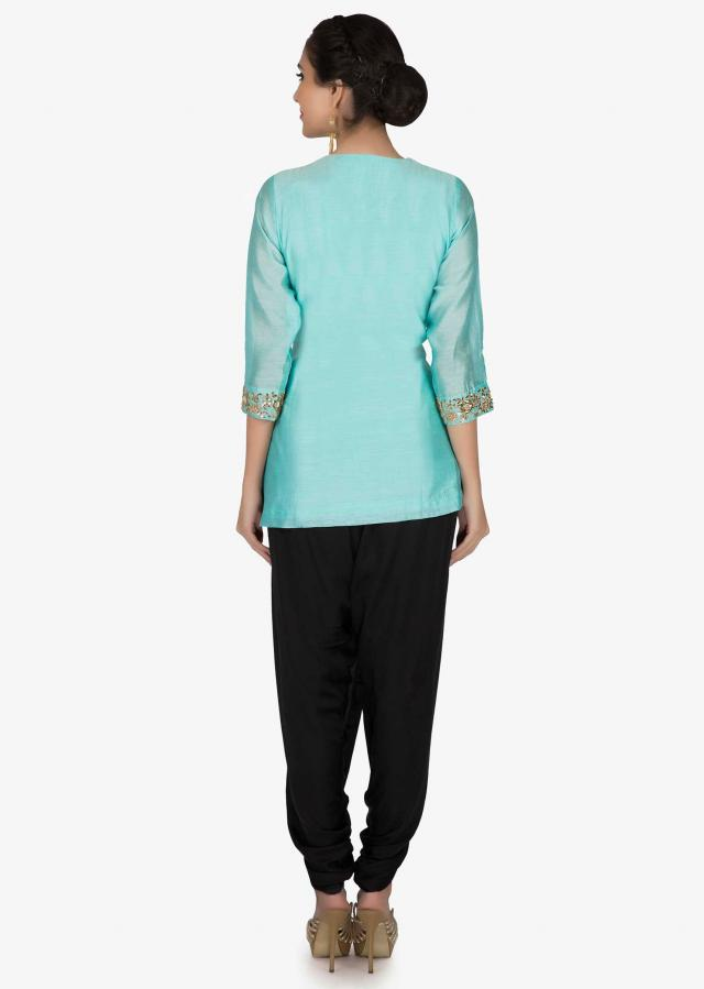 Turq suit in embroidered placket matched with dhoti pants only on Kalki