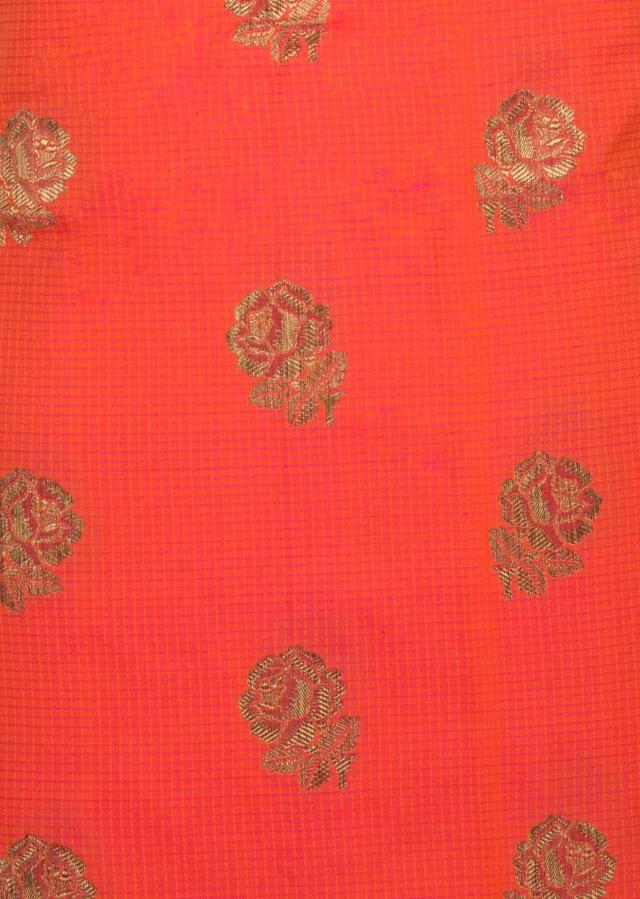 Unstitched suit in bright orange with rani pink dupatta only on Kalki