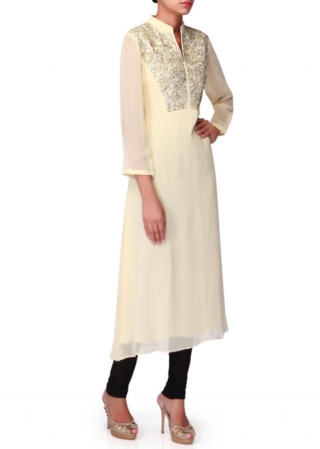 Vanilla cream kurti with embellished placket only on Kalki