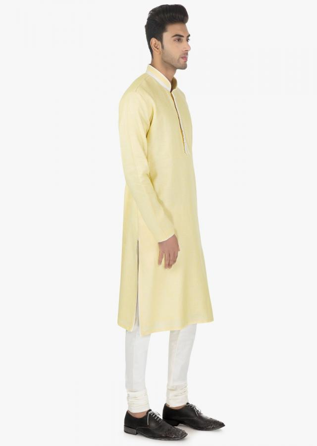 Vanilla cream silk kurta and White linen chudidar set only on kalki