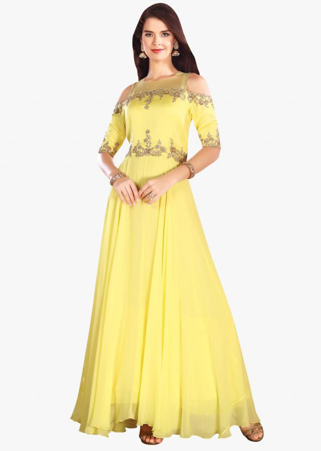 Vibrant yellow gown in georgette with cold shoulder and embroidered bodice