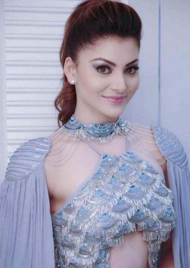 Urvashi Rautela in kalki halter neck jumpsuit styled with pleated draped shoulder pads attached with the neck belt