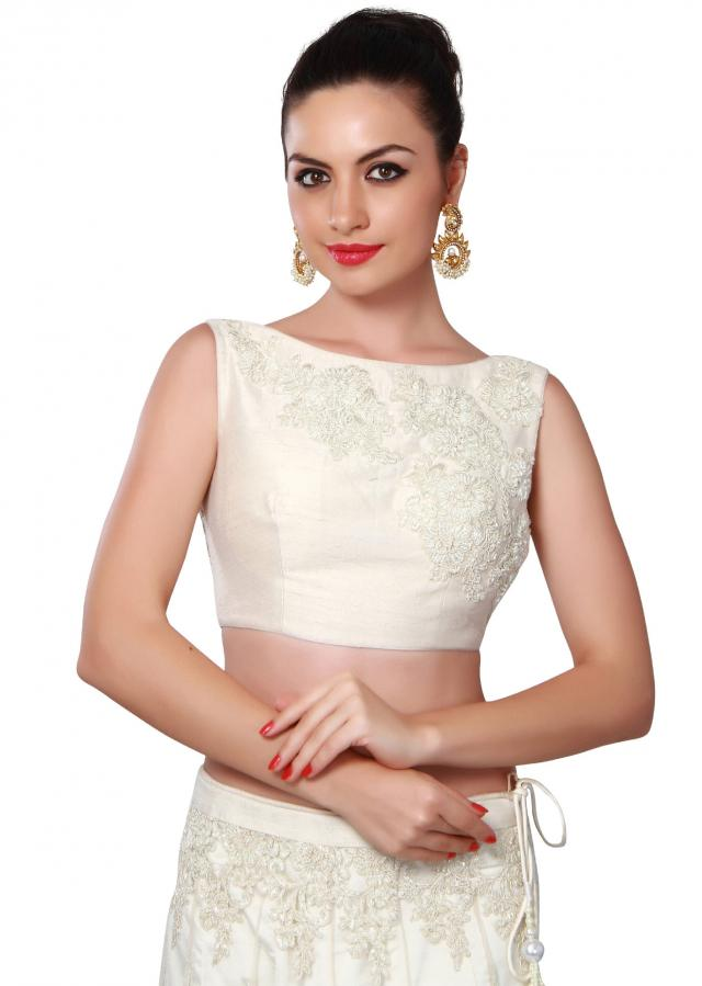 White lehenga adorn in resham and kardana embroidered butti only on Kalki