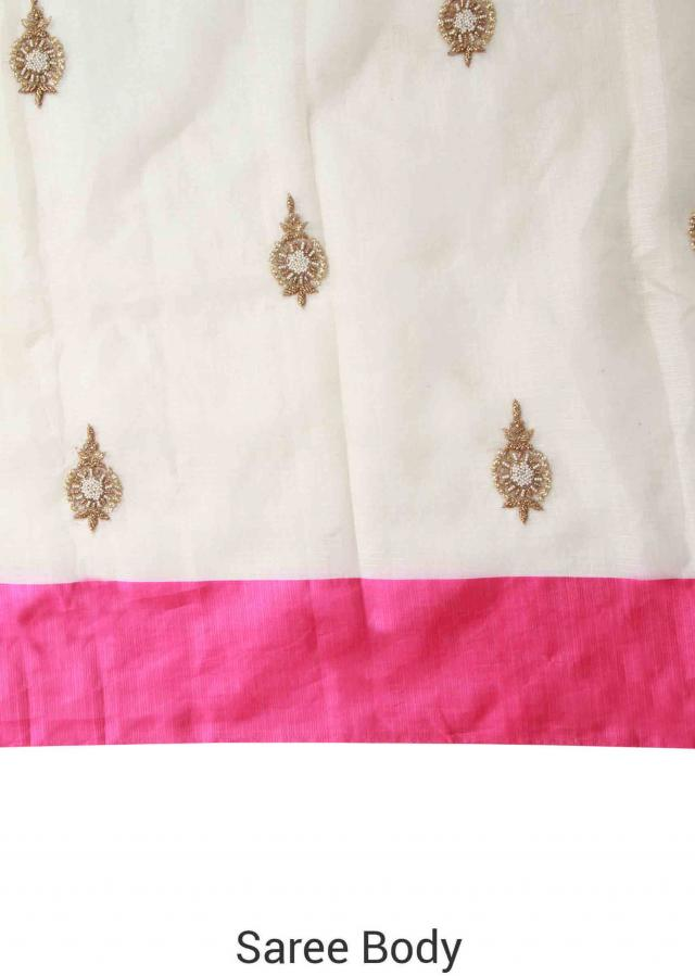 White saree adorn in embroidered butti and pink border only on Kalki