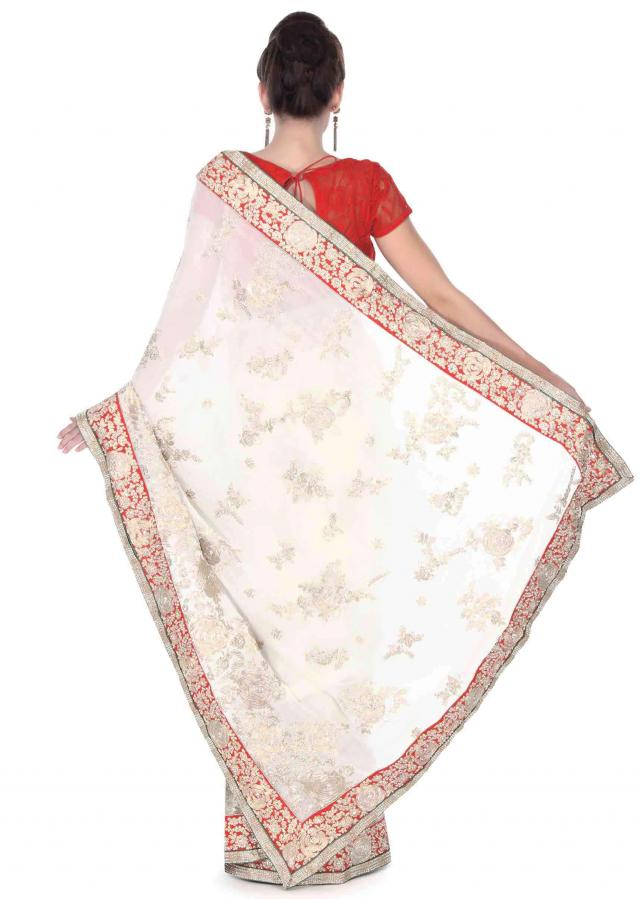 White saree in floral motif embroidery in sequin only on Kalki