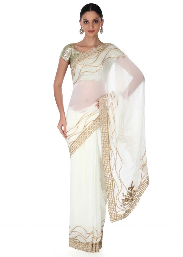 White saree adorn in gold embroidered border only on Kalki