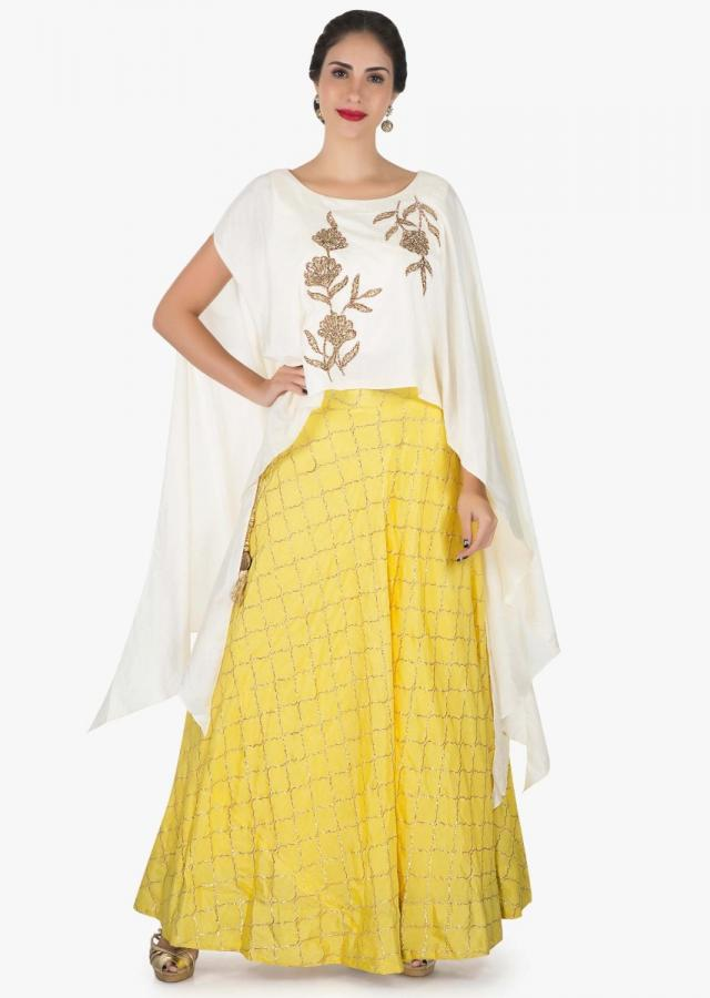 White and yellow skirt and top embellished in zari and zardosi embroidery work only on Kalki