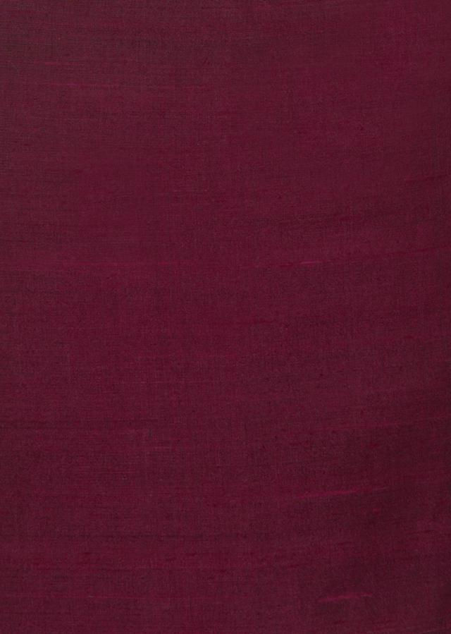 Wine raw silk unstitched suit enhanced with zari hemline only on Kalki